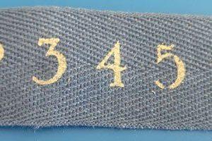 Cinta en color azulón de algodón con números en claro
