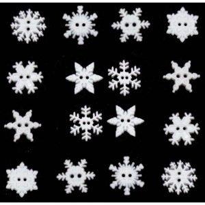Botones de estrellas y copos de nieve en blanco