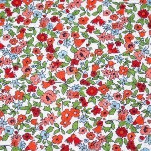 Tela de florecitas claras tipo liberty de algodón hidrofugo y antibacteriano. TECNOSANI