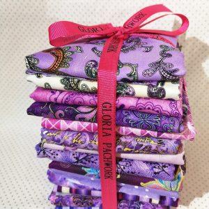 Pack de 14 telas en tonos lilas y morados variados.Total 1.75 metros