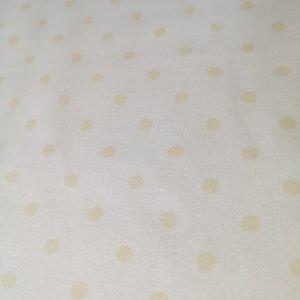 Tela de lunaritos en color vainilla( sobre claro1,50)