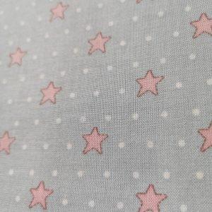 Estrellas rosas y lunares sobre rosa claro.With love.Veronique Requena