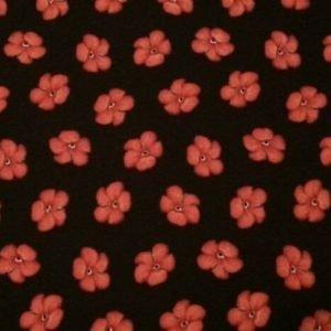 Tela con florecitas rojas sobre negro de quilting treasures